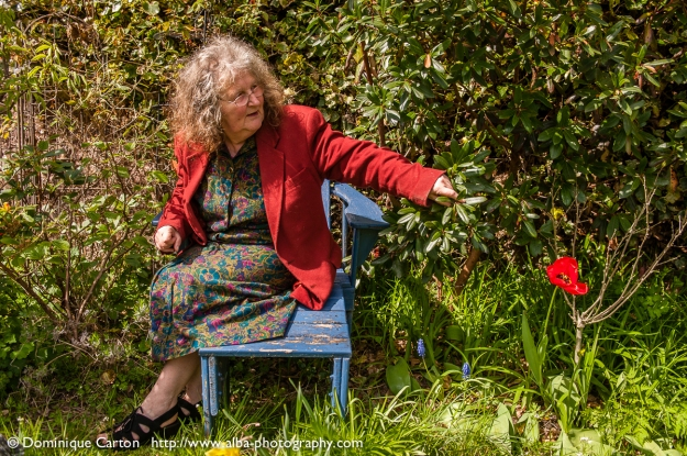 Sally Evans, poet and bookseller in the garden